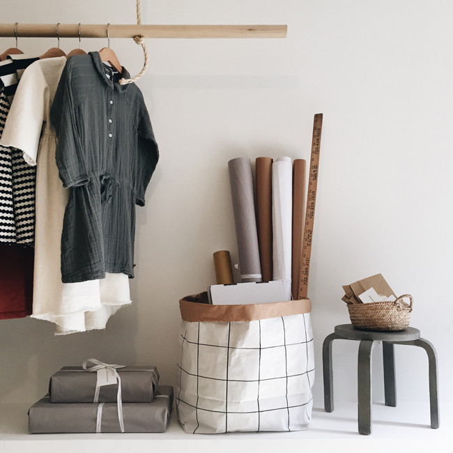 The Paper Bag Grid(from $20) by Stockholm's Tellkiddo, with a rack of assorted looks.