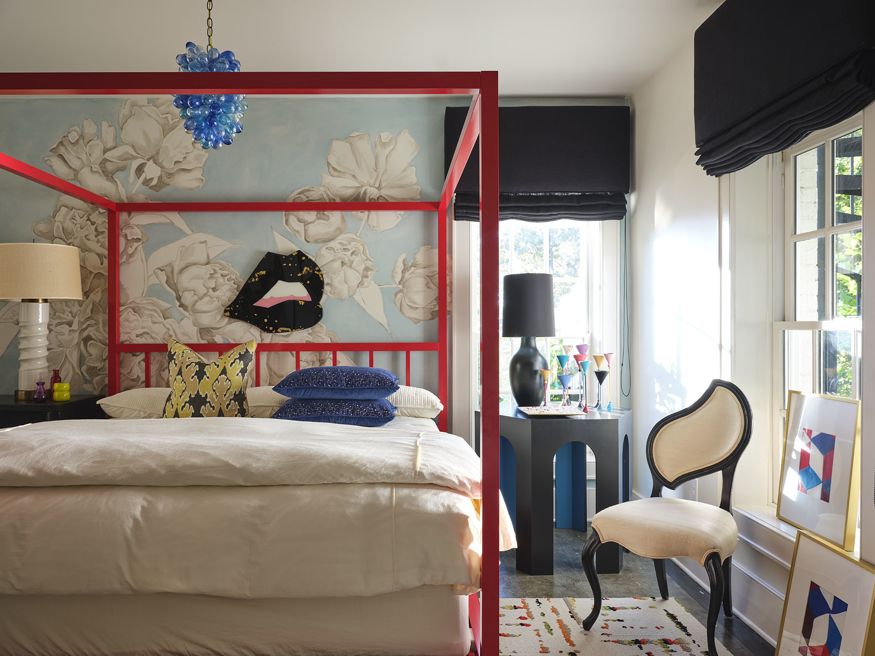 Blehm's passion for sourcing unique vintage furniture comes to the fore in the bedroom with varied sculptural pieces and ample texture. Pottery Barn Bedding | Angela Chrusciaki Blehm Mural and Lips Art | Flor Area Rug | Vintage Pendant Light | Vintage Table Lamps |