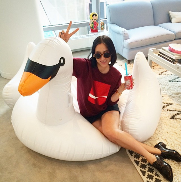 Eva Chen lounges on a Sunnylife swan.
