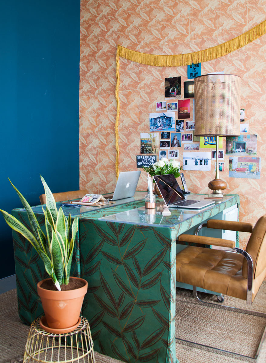 A pair of CB2 desks allows for easy communication.
