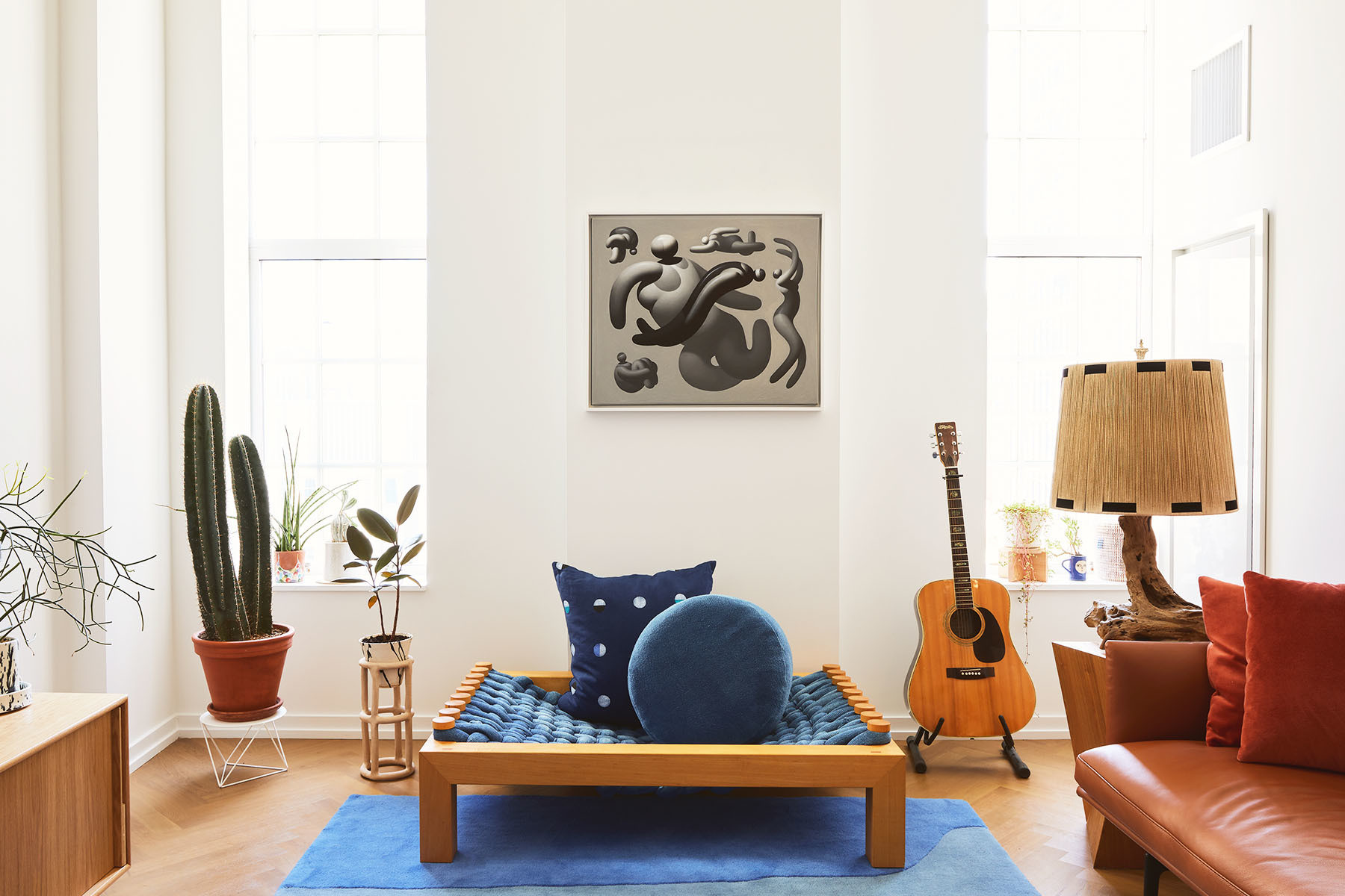 Virginia Sin's Williamsburg apartment showcases the designer's own unique creations. Design Within Reach Credenza | Sin Ceramics Planter | Cold Picnic Rug | Gubi Coffee Table | Vintage Guitar | Mike Lee Artwork | Vintage Floor Lamp | Muuto Sofa | Porter James Vintage Pillows | BTW, Group Partner Ceramics.