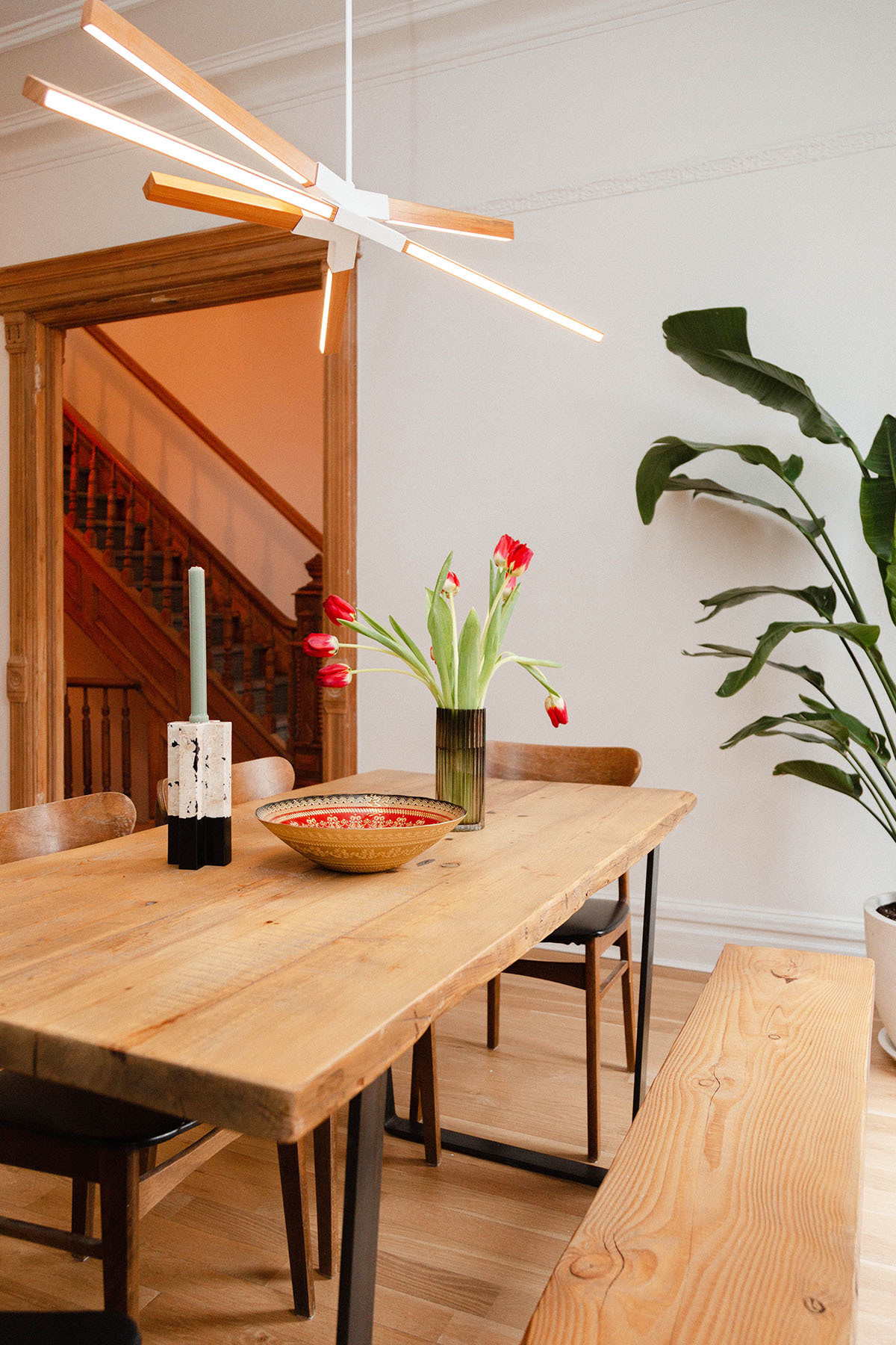 In a bid to cut costs and complete a sustainable renovation, the duo repurposed old furniture — like the custom Etsy dining table — that previously held pride of place in Bordelon's New York apartment.