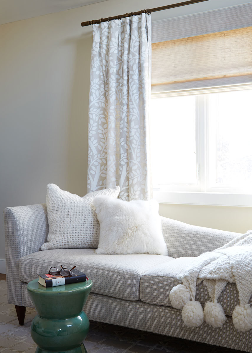An adjacent seating area hosts a cozy Thomas Pheasant chaise, Madegoods stool, and a pom-pom throw from Going's online shop.