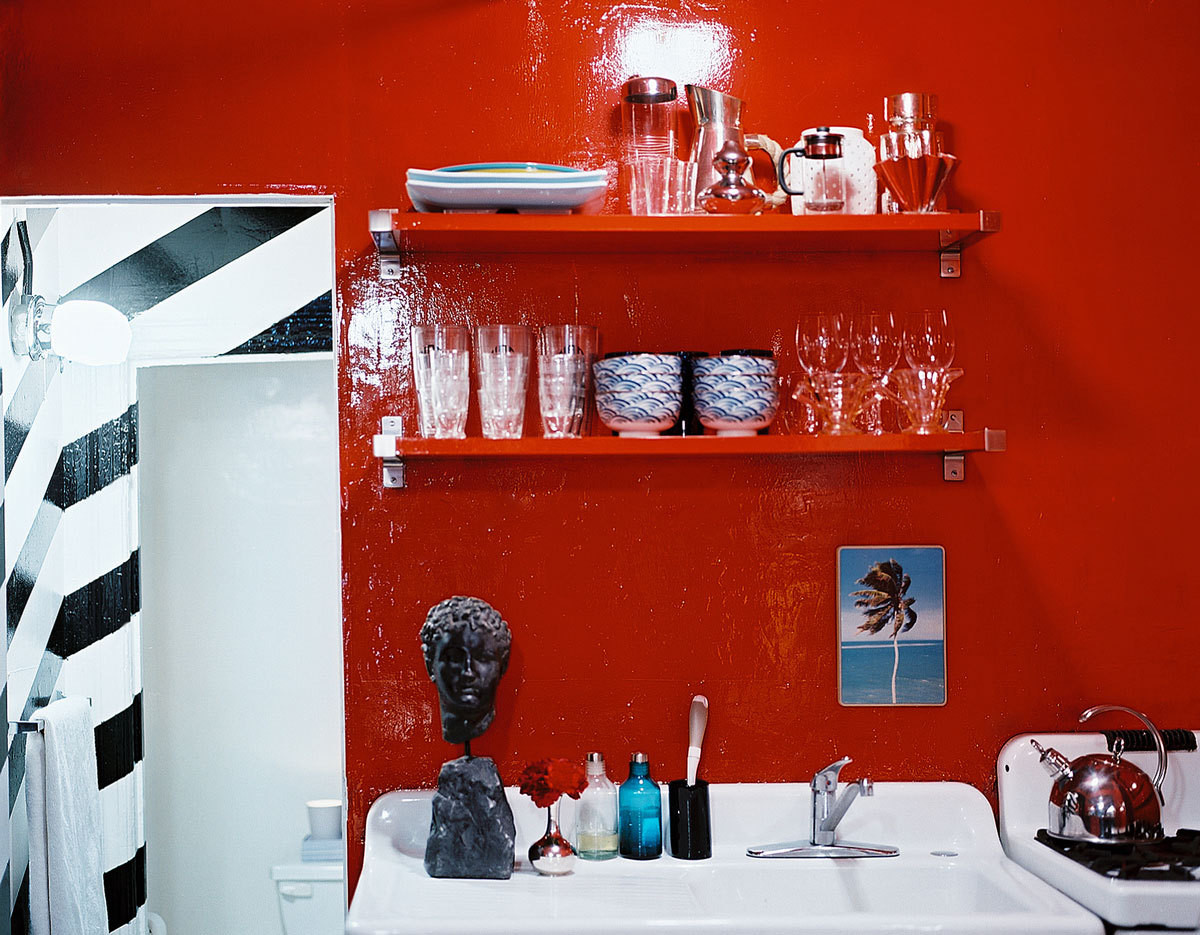 """Few things got in between Olsen and his high-gloss shade of red, including a kitchen window. """"It had already been painted shut when I moved in, plus it looked out onto a shaft. So I just painted the entire thing red."""""""