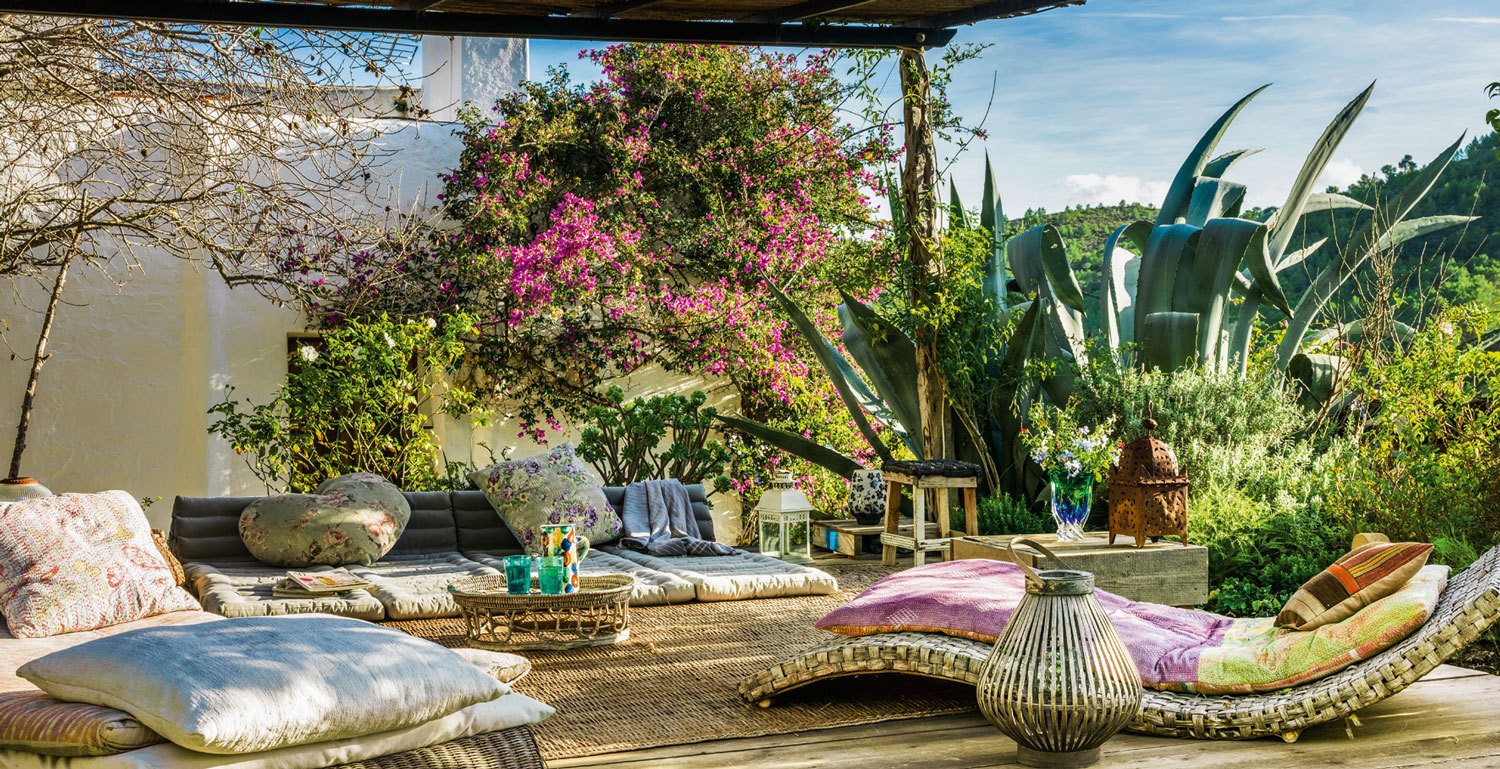 A shaded outdoor seating area at Es Pouas, a country house near Santa Agnes.