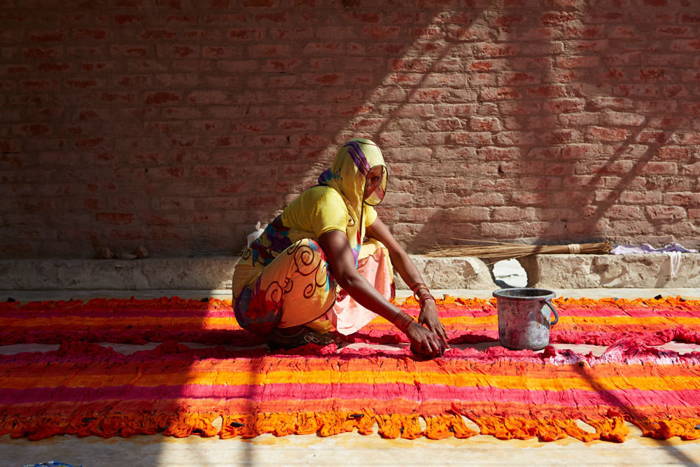 Saturated hues, such as those on the work of this textile maker, abound throughout India.