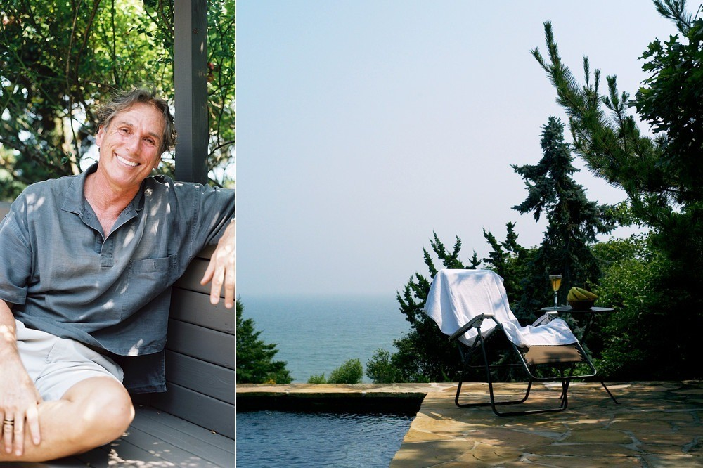 Designer Vicente Wolf reclines at home in Montauk, New York.