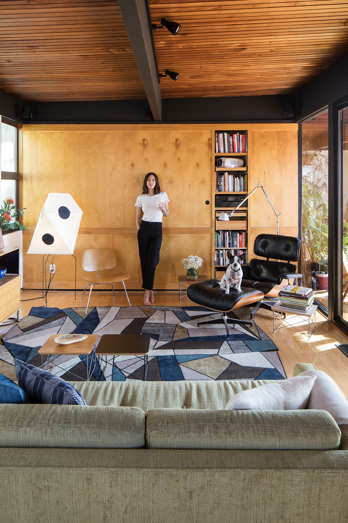 """We get a lot of comments about how our house has this classic L.A. vibe. I think a mid-century post and beam on a steep hillside is possibly the most quintessentially L.A. home there is,"" Plambeck admits, pictured here with the couple&squot;s beloved pup, Bean. Vintage Sofa 