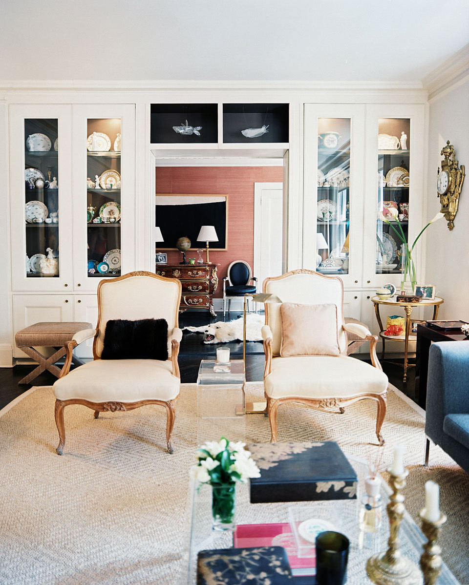 The living room's neutral backdrop allows the couple's collectino of art and antiques to become the focal point.