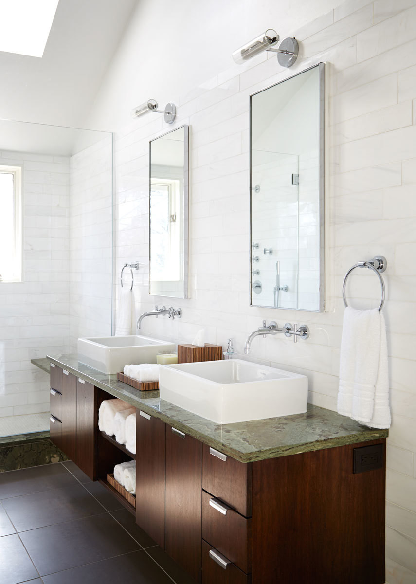 Green Serpentinite countertops and dark-wood cabinetry sidestep the all-white bathroom trend in the master suite.