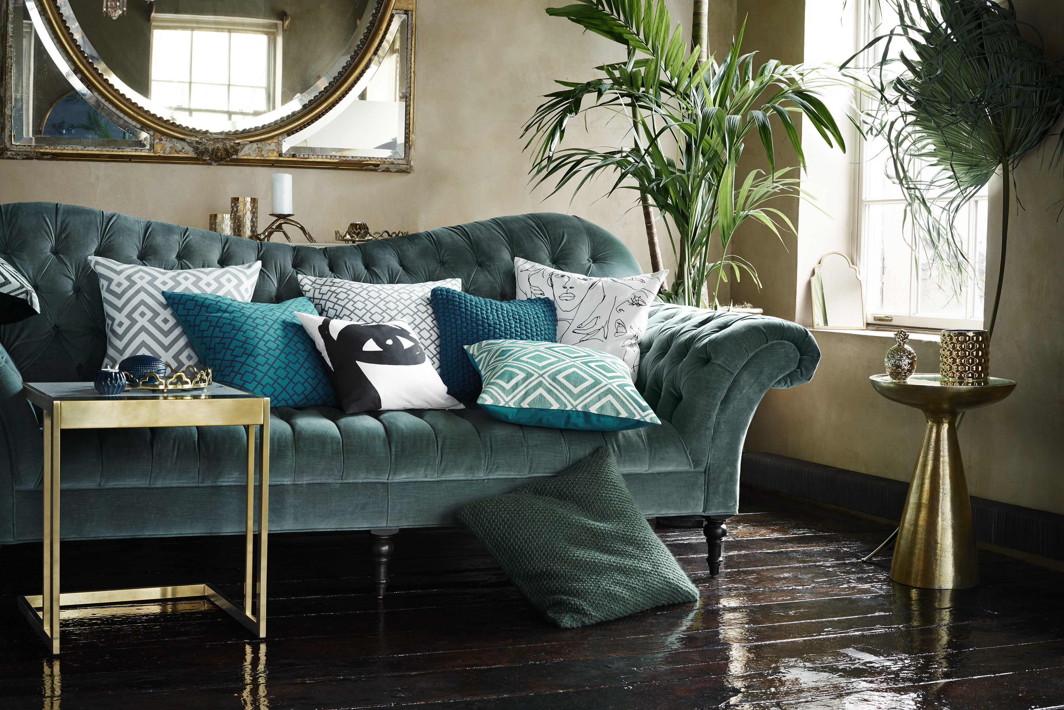 Plush hues of gray, teal, and green flirt with gold metal accents in H&M Home's Fall 2015 line. All photos courtesy of H&M Home.