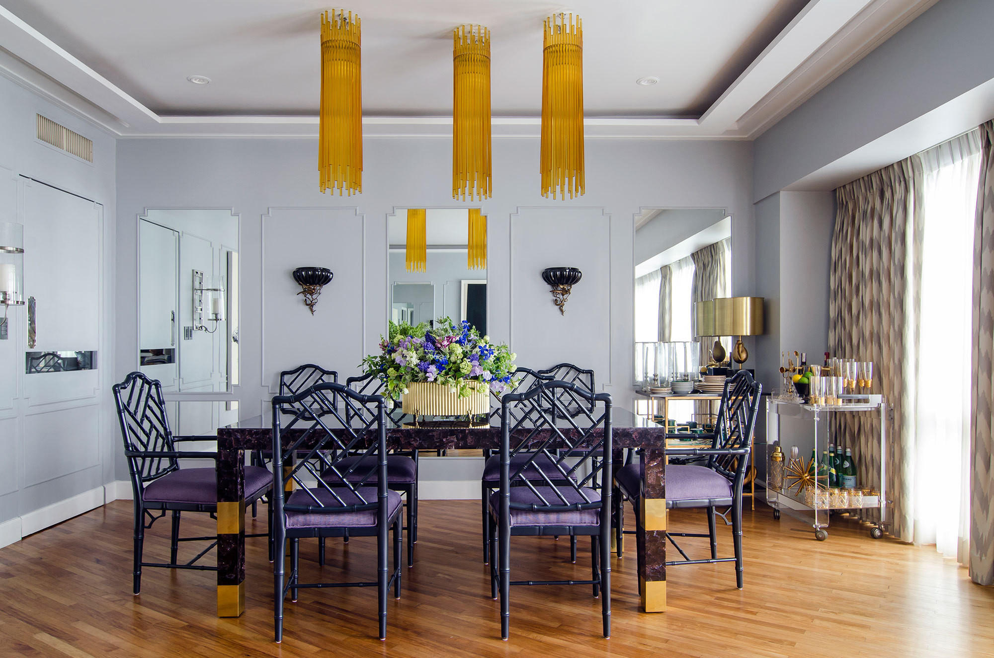 Chippendale chairs surrounded a brass-and-shell table from Carreon's collection. The designer added the room's moldings and mirrored wall panels.