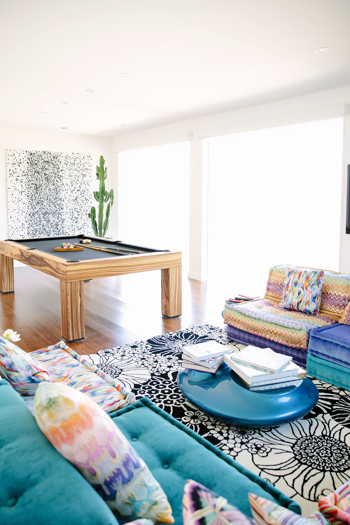 """My favorite piece? Our Missoni Mah Jong Sofa by Roche Bobois,"" smiles Fister. ""I was lucky enough to consult for them for many years and with that had the opportunity to purchase this special piece."" Don Popkes Artwork 