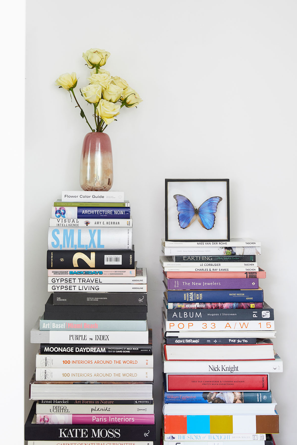 Stacks of books provide ample inspiration for the busy designer, who works primarily from home.