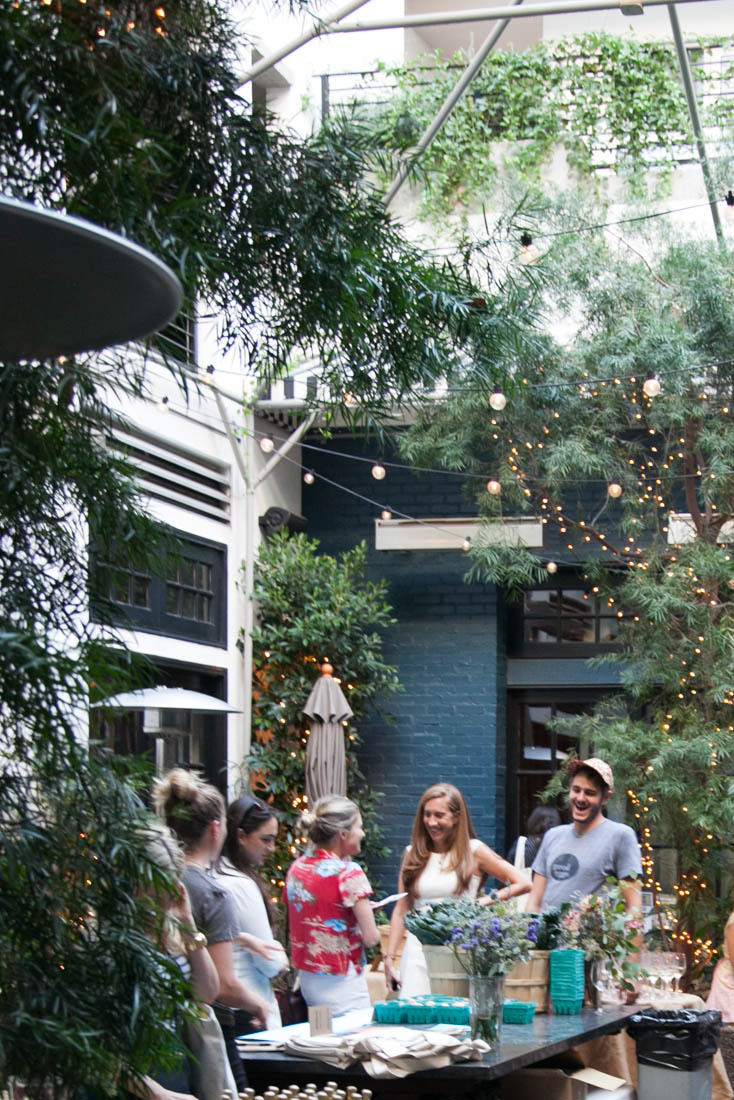 Attendees mingle in the courtyard at Palihouse.