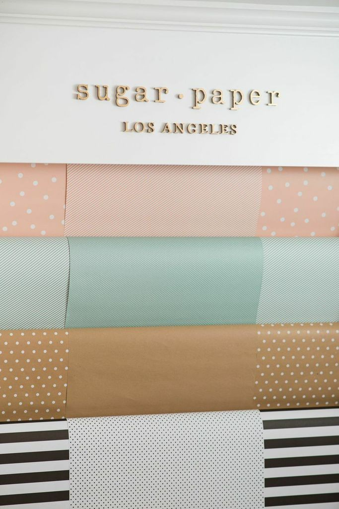 The brand's adorable wrapping paper hangs from one wall.