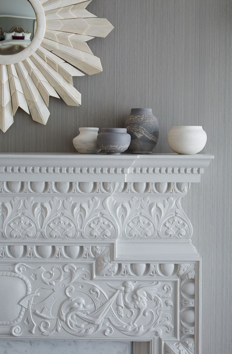 """It's always worth trying to preserve things,"" says Scodro, who transformed the room's old European fireplace from a dark bronze to a creamy white by painting the detailed façade."