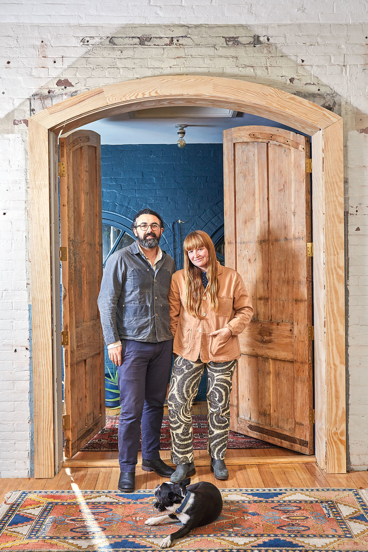 """""""We definitely wanted a unique space with character and historical significance that we could renovate or transform the way that we wanted — but on a manageable scale,"""" the designer recalls, pictured here with MacKean and the couple&squot;s beloved pup, Tux. Vintage Turkish Runners 