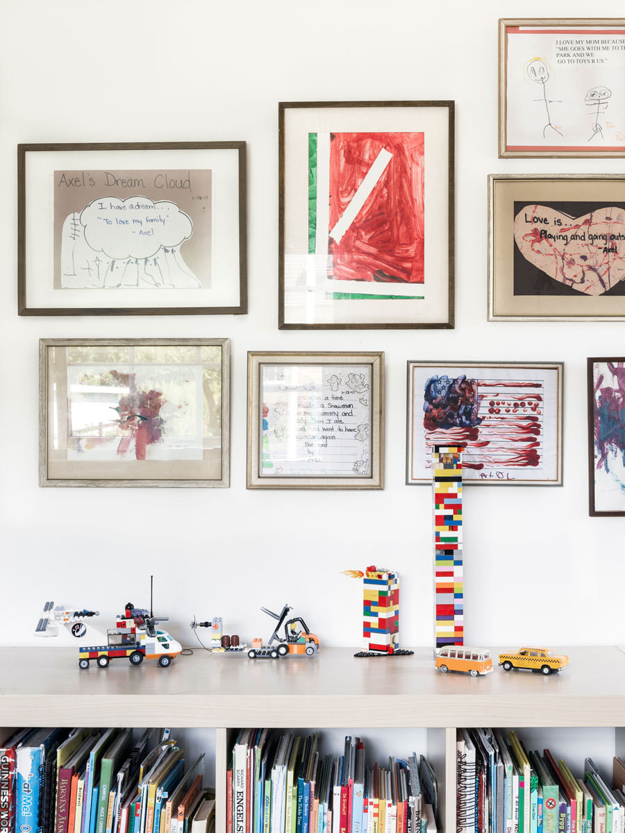 The children's artwork and toys add color to the space.