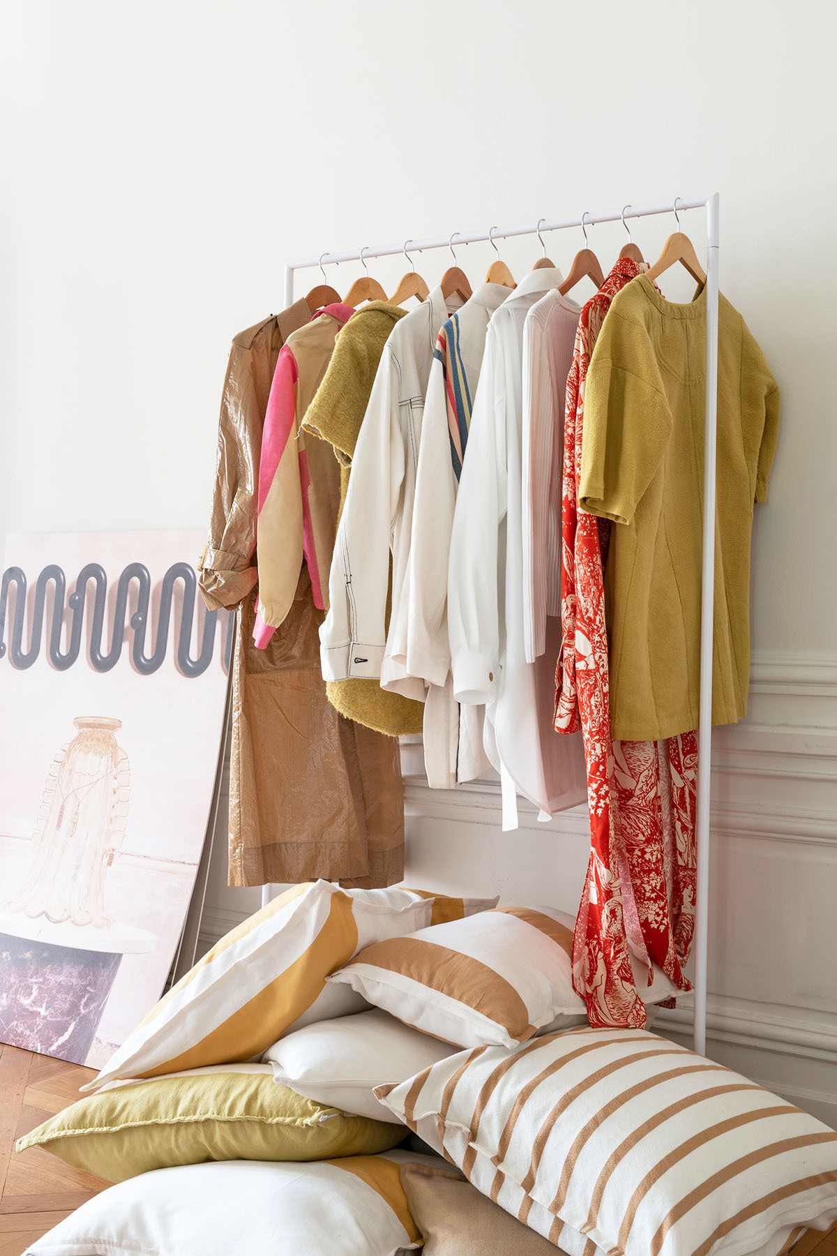 """""""I ordered this clothes rack when we started producingLucy Folk Apparel — I fast grew out of my wardrobe!"""" says the designer.Marrakshi Life Custom Pillows."""