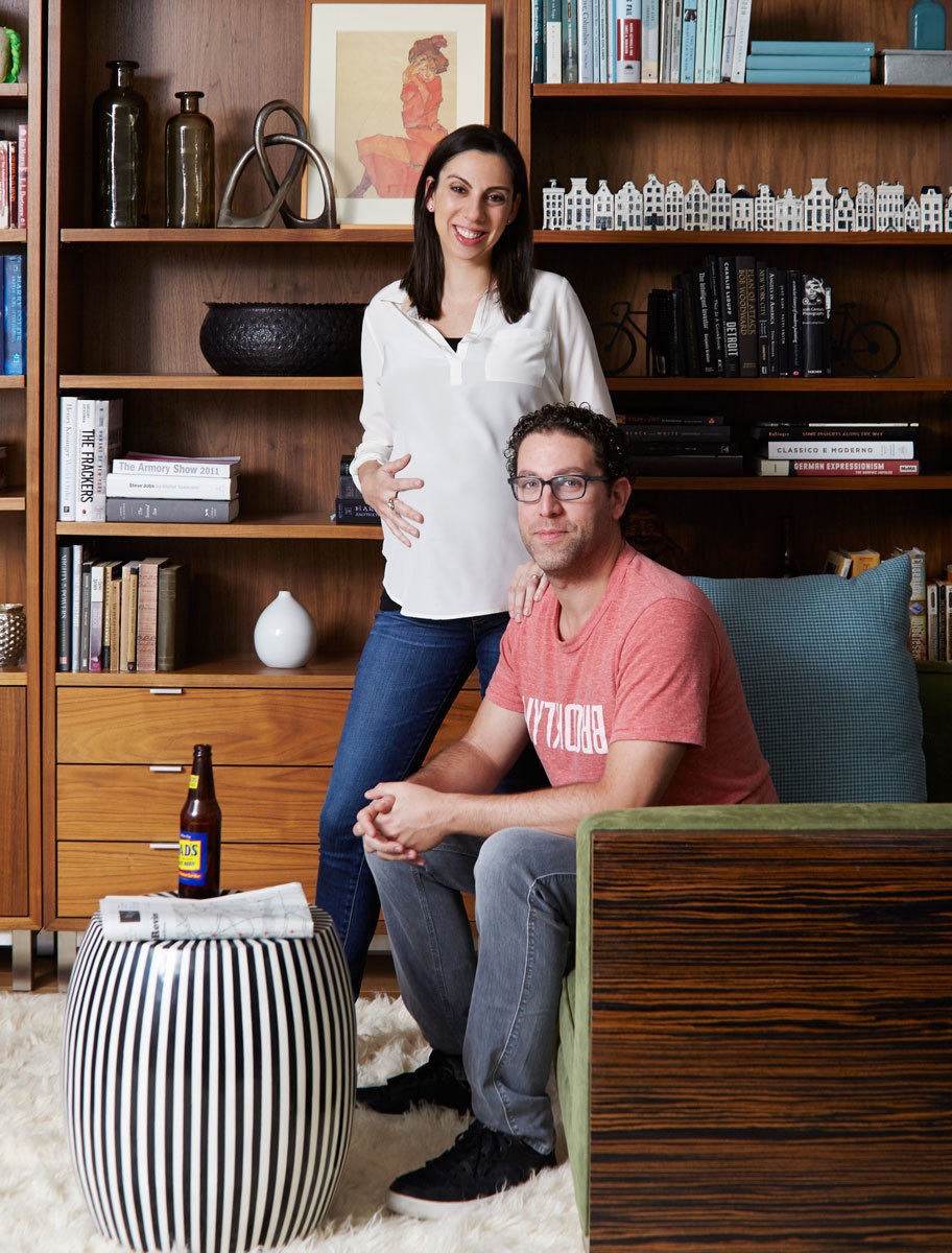 Homeowners Lana and Steven Kleimen in the multipurpose library-playroom area of their sun-filled apartment.