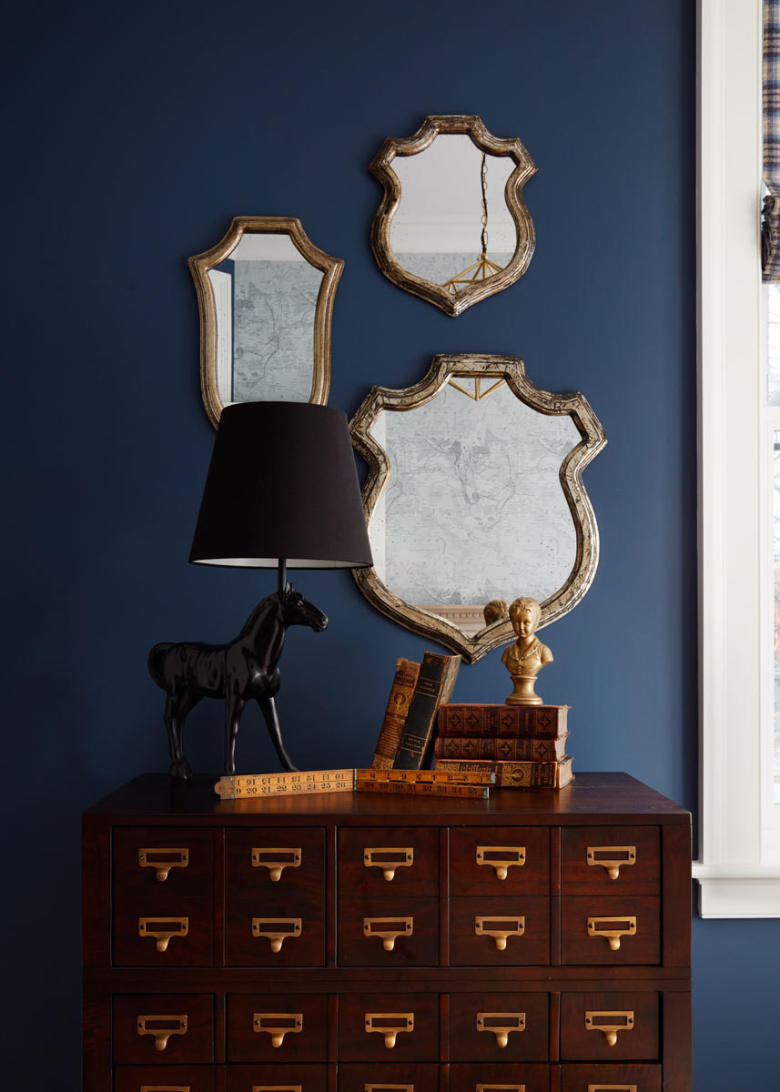 An equestrian lamp from Clayton Gray Home sits atop a card catalog–inspired dresser from the Land of Nod.