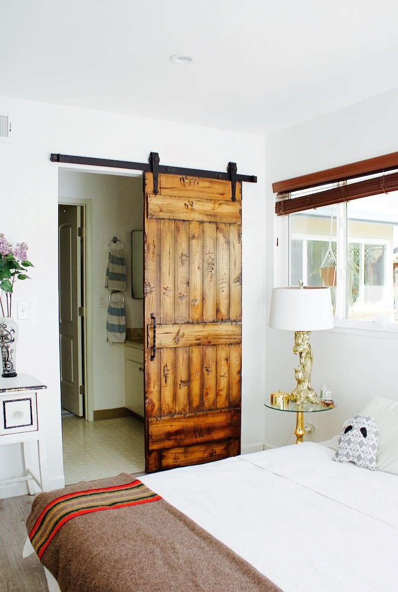 A Barn Door On Sliding Sections Off The Master Bedroom From Bath And Brings
