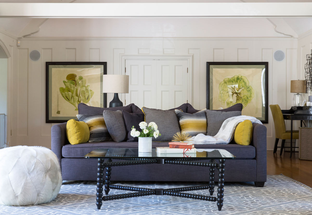 In the media room, a deep custom-made sofa by Moss Studio is one of the family's favorite places to congregate.