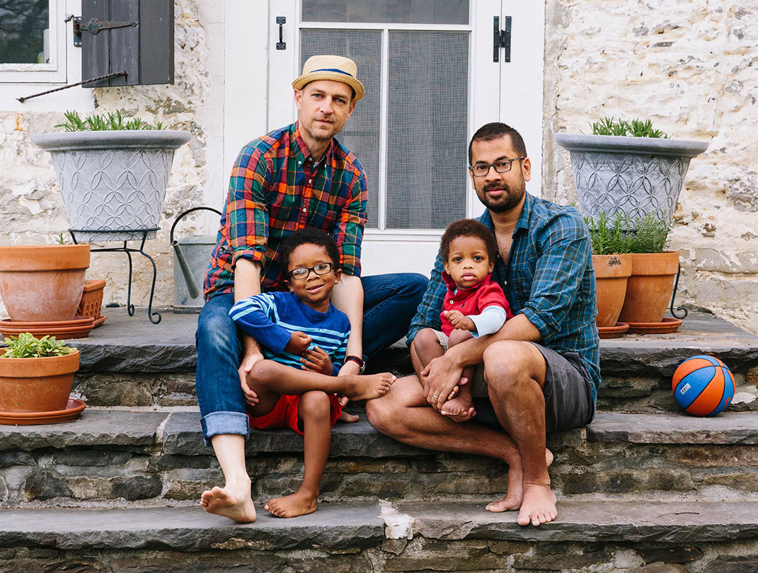 David Land (left) and Rumaan Alam with their sons—Simon, 4, and Xavier, 21 months—on the steps of Kid & Coe's Whitfield Road Residence, in Accord, New York.