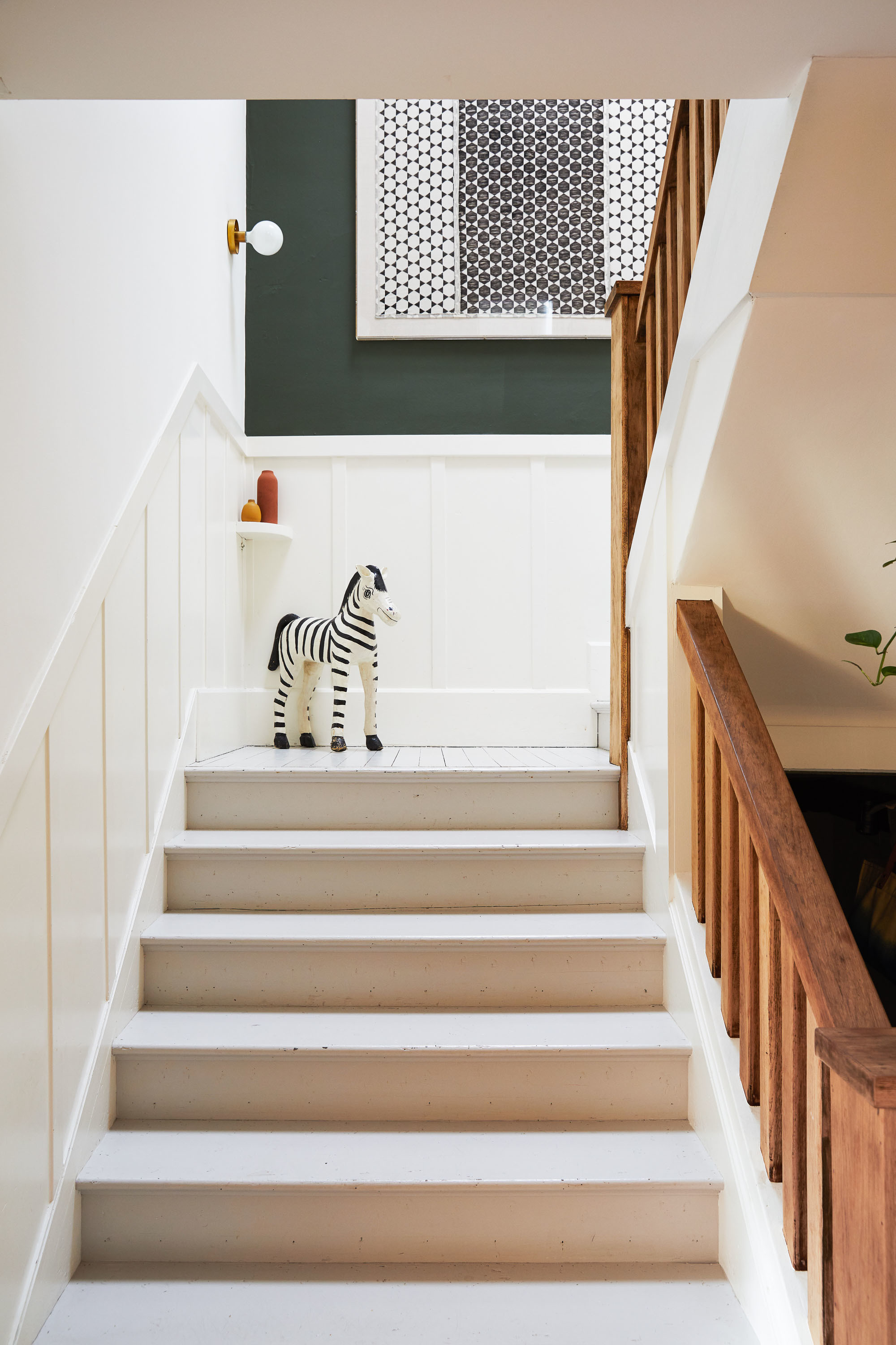 Green walls breathe new life into the heritage home. Sherwin Williams Paint | St. Frank Textile | Vintage Zebra | Heath Ceramics and The Citizenry Vases.